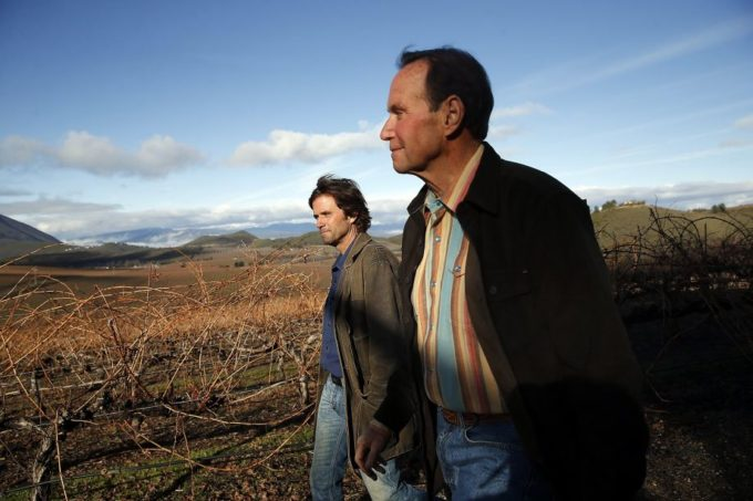 Andy Beckstoffer & son David at Amber Knolls Vineyard, photo credit Scott Strazzante, SF Chronicle
