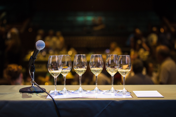 Microphone and six glasses of white wine set up for a technical tasting